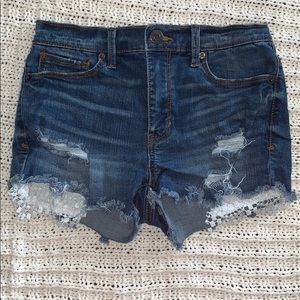 Distressed jean shorts with lace
